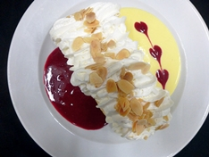 "Try our traditional House Specialty ""Pavlova"" dessert."